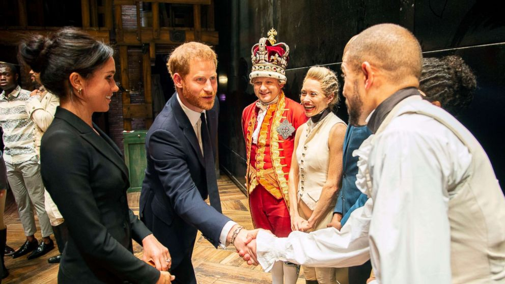 Prince Harry and Duchess Meghan Markle of Sussex after the performance meeting cast and crew backstage at the Victoria Palace Theatre, London, Aug. 30, 2018.
