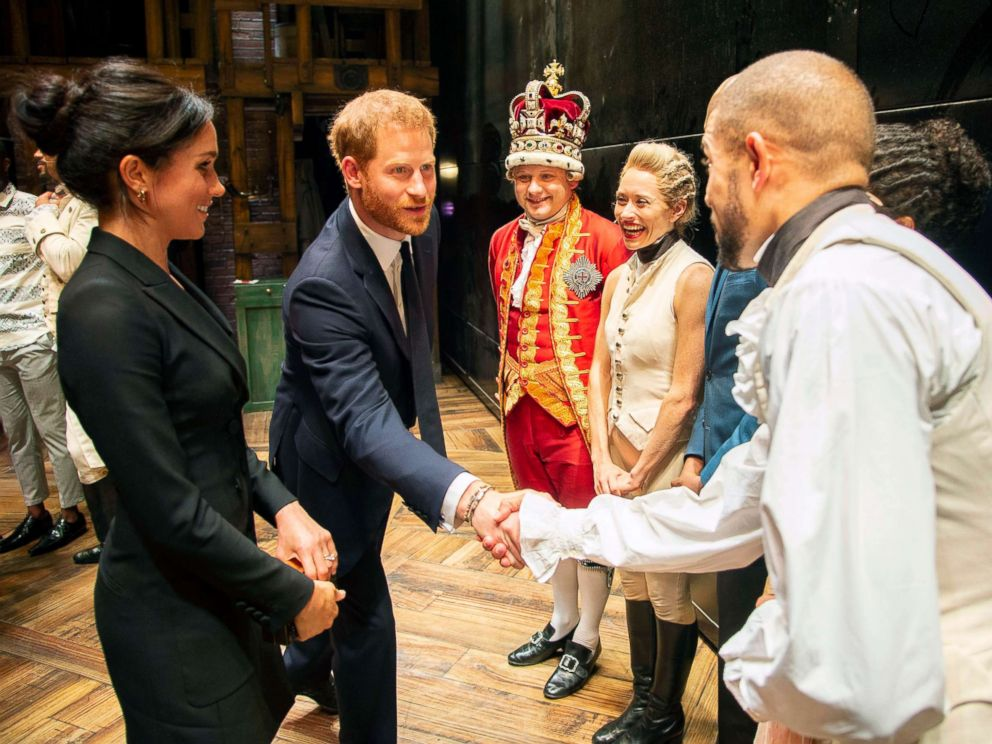 PHOTO: Prince Harry and Duchess Meghan Markle of Sussex after the performance meeting cast and crew backstage at the Victoria Palace Theatre, London, Aug. 30, 2018.