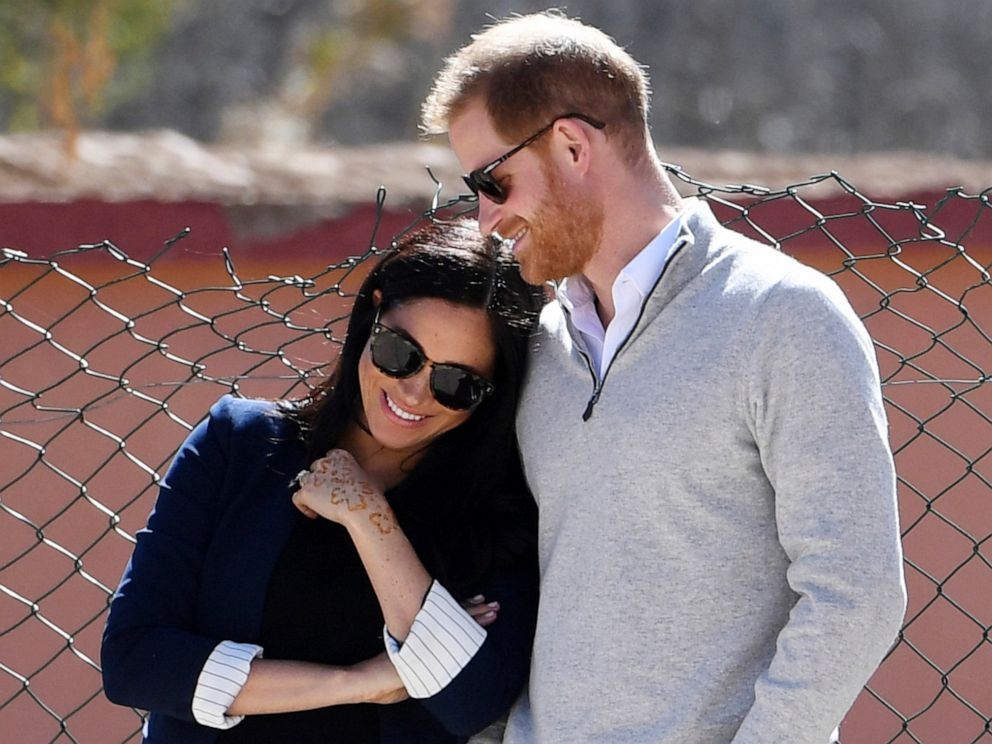 PHOTO:Britains Prince Harry and Meghan, Duchess of Sussex, watch children playing football at a school in the town of Asni, in the Atlas mountains, Morocco, Feb. 24, 2019.