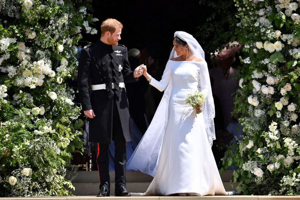 PHOTO: Prince Harry and Meghan Markle leave from the West Door of St Georges Chapel, Windsor Castle, May 19, 2018, in Windsor, England.