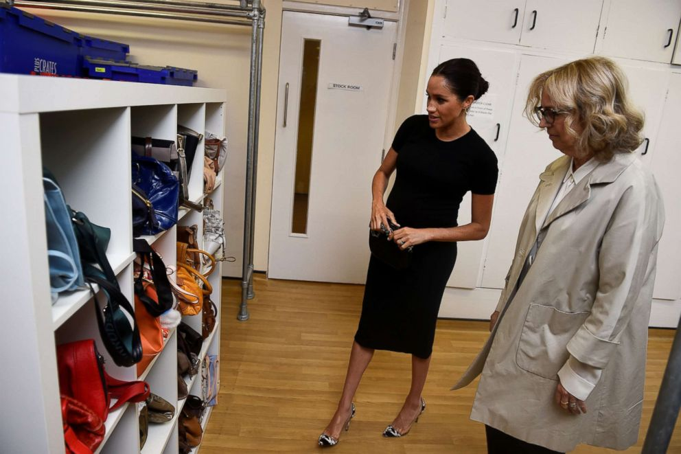 Meghan Markle, the Duchess of Sussex, looks at bags with Lady Juliet Hughes-Hallett during her visit at Smart Works charity in West London, Jan. 10, 2019.