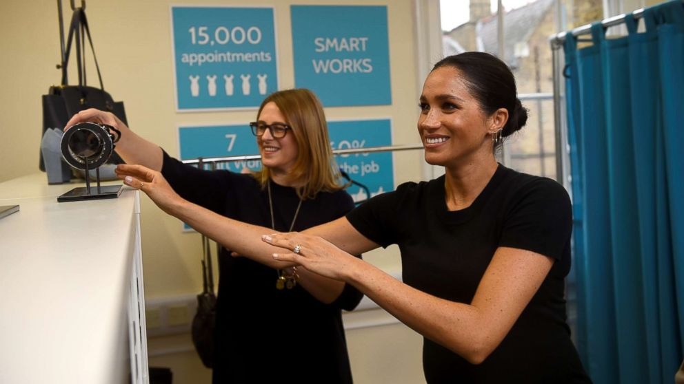 Britain's Meghan Markle, Duchess of Sussex  picks out a bracelet during her visit to Smart Works, a charity to which she has become patron, at St Charles hospital in west London, Jan. 10, 2019.