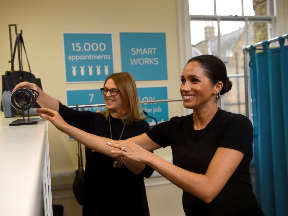 PHOTO: Britains Meghan Markle, Duchess of Sussex picks out a bracelet during her visit to Smart Works, a charity to which she has become patron, at St Charles hospital in west London, Jan. 10, 2019.