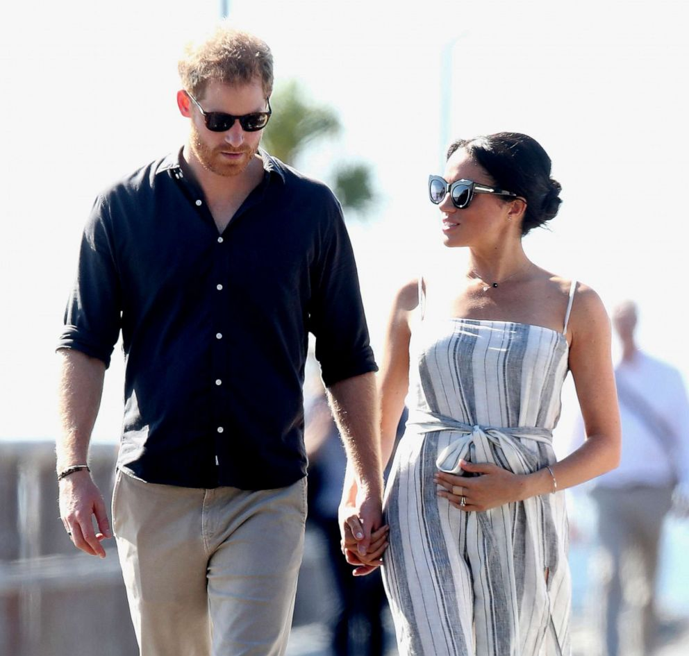 PHOTO: Prince Harry, Duke of Sussex and Meghan, Duchess of Sussex walk along Kingfisher Bay Jetty, Oct. 22, 2018, in Fraser Island, Australia.