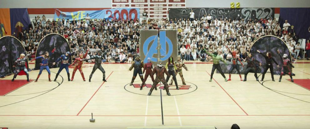 "PHOTO: The PAC Dance Team from Walden Grove High School perform a ""Marvel""-themed homecoming dance."