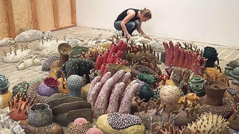 Sculptor Courtney Mattison installs an exhibition of her work.