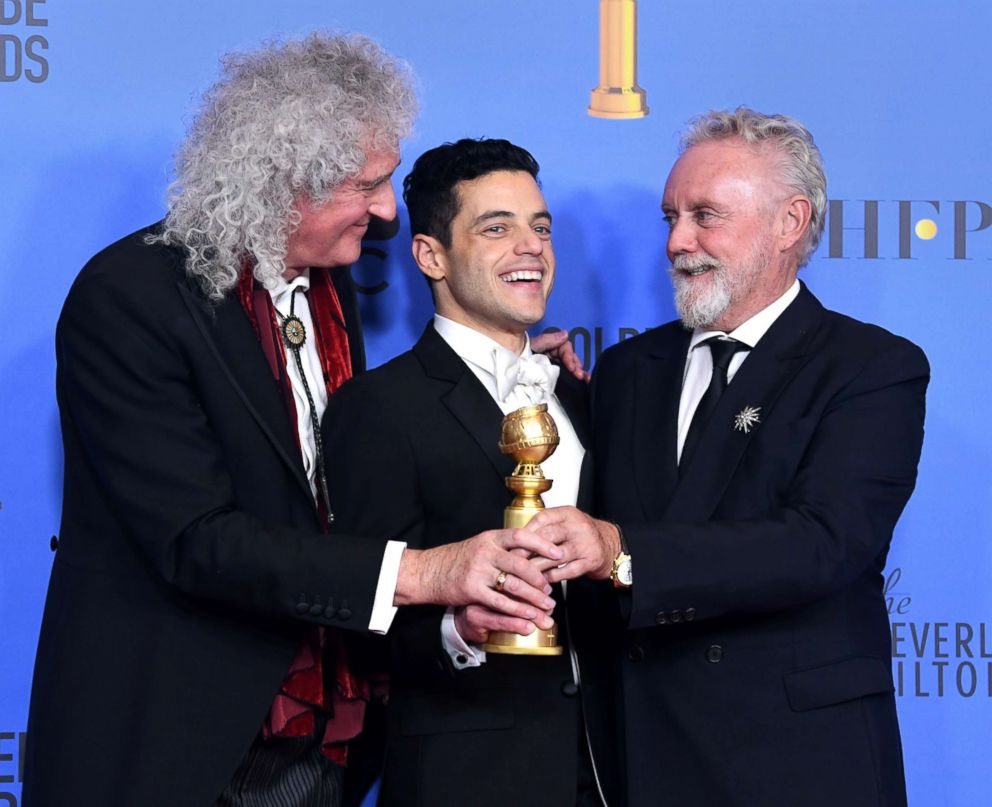 Rami Malek, center, celebrates his win for Best Actor in a Motion Picture Drama for 'Bohemian Rhapsody' and poses with Brian May and Roger Taylor, right, of Queen in the press room during the 76th Annual Golden Globe Awards, Jan. 6, 2019 in Beverly Hills, Calif.