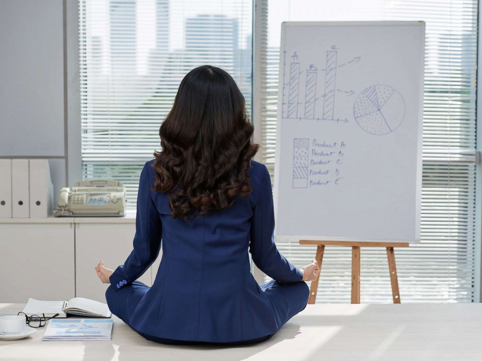PHOTO: A businesswoman is pictured meditating in this undated stock photo.