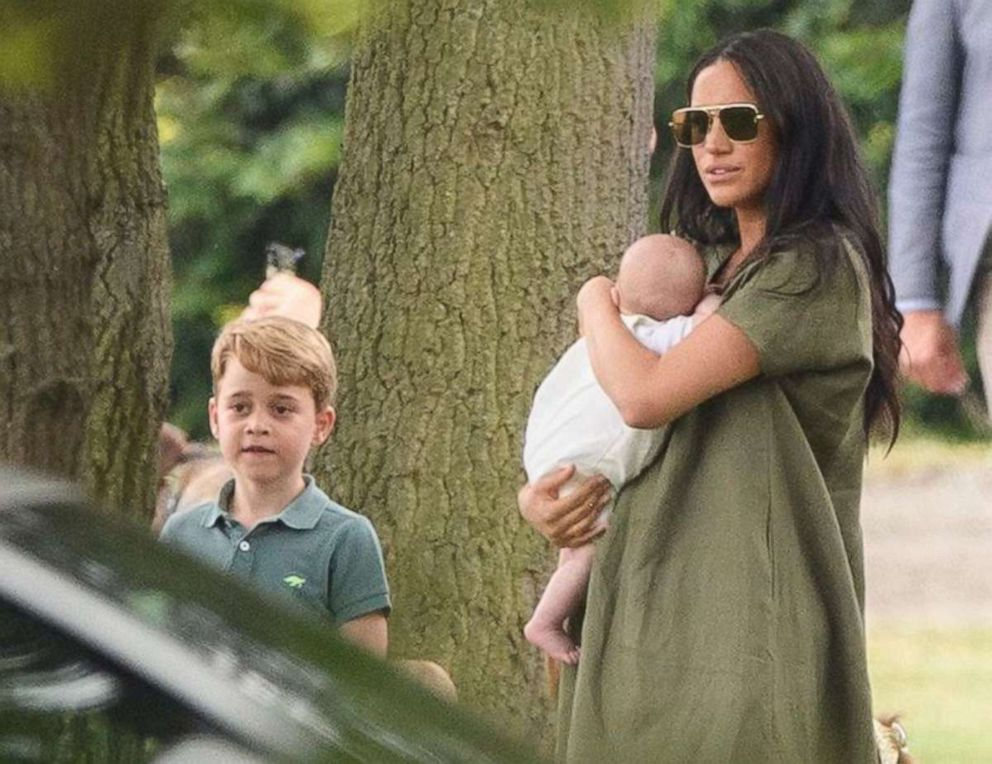 PHOTO: Prince George, Meghan, Duchess of Sussex and Archie Mountbatten-Windsor arrive at the King Power Royal Charity Polo Day at Billingbear Polo Club in Wokingham, England, July 10, 2019.