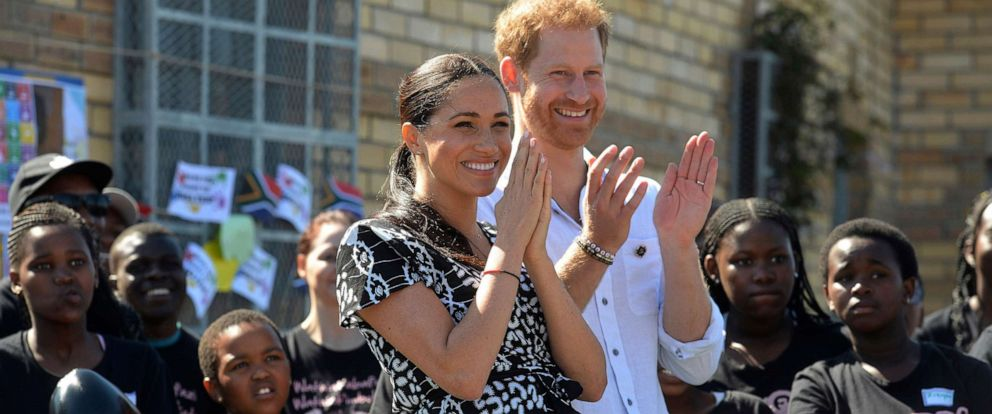 PHOTO: Britains royal couple Prince Harry and Meghan, Duchess of Sussex, greet youths on a visit to the Nyanga Methodist Church in Cape Town, South Africa, Sept, 23, 2019.