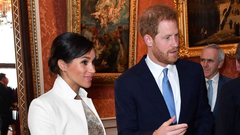 Britain's Meghan, Duchess of Sussex and Prince Harry the Duke of Sussex are seen at a reception to mark the fiftieth anniversary of the investiture of the Prince of Wales at Buckingham Palace in London, March 5, 2019.