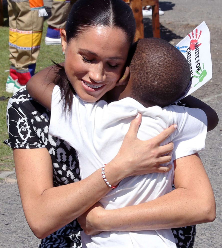 PHOTO: Meghan, Duchess of Sussex receives a hug from a young boy during a visit at a Justice Desk initiative in Nyanga township, with Prince Harry, Duke of Sussex, during their royal tour of South Africa, Sept. 23, 2019 in Cape Town, South Africa.