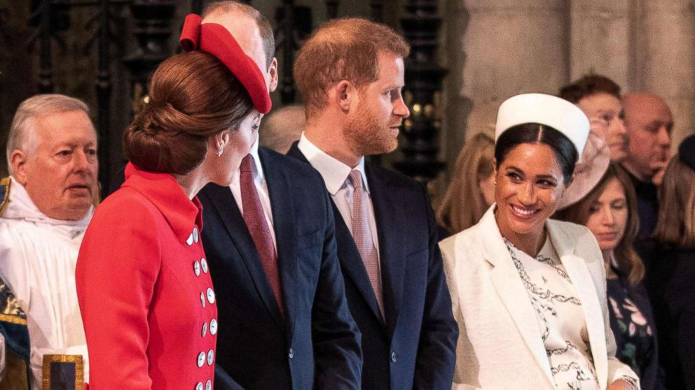 Britain's Catherine, Duchess of Cambridge, talks with Britain's Meghan, Duchess of Sussex, Prince William and Prince Harry stand by attending the Commonwealth Day service at Westminster Abbey in London on March 11, 2019.