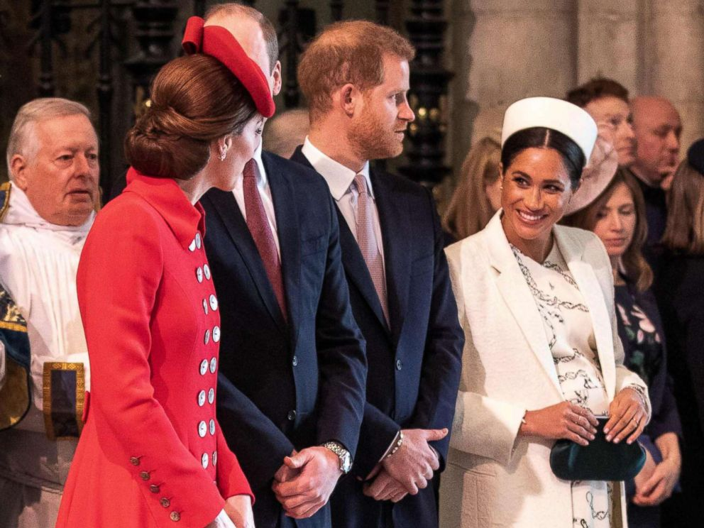 PHOTO: Britains Catherine, Duchess of Cambridge, talks with Britains Meghan, Duchess of Sussex, Prince William and Prince Harry stand by attending the Commonwealth Day service at Westminster Abbey in London on March 11, 2019.