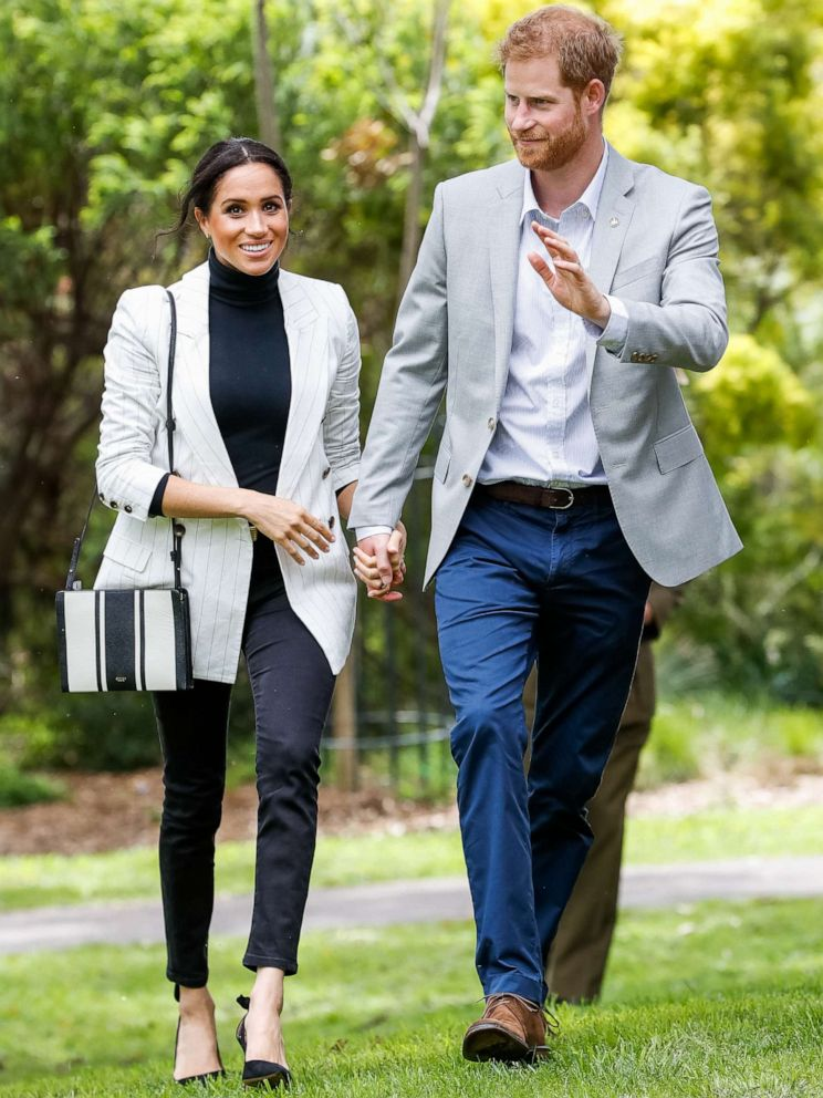 PHOTO: Prince Harry and Meghan, Duchess of Sussex, walk together during day two of the Invictus Games Sydney 2018 at Sydney Olympic Park on Oct. 21, 2018 in Sydney.