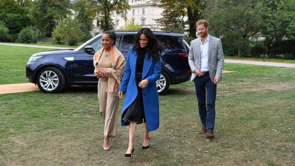 Meghan Markle, the Duchess of Sussex, accompanied by Britain's Prince Harry, the Duke of Sussex and her mother Doria Ragland walk to attend a reception at Kensington Palace, in London, Sept. 20, 2018.