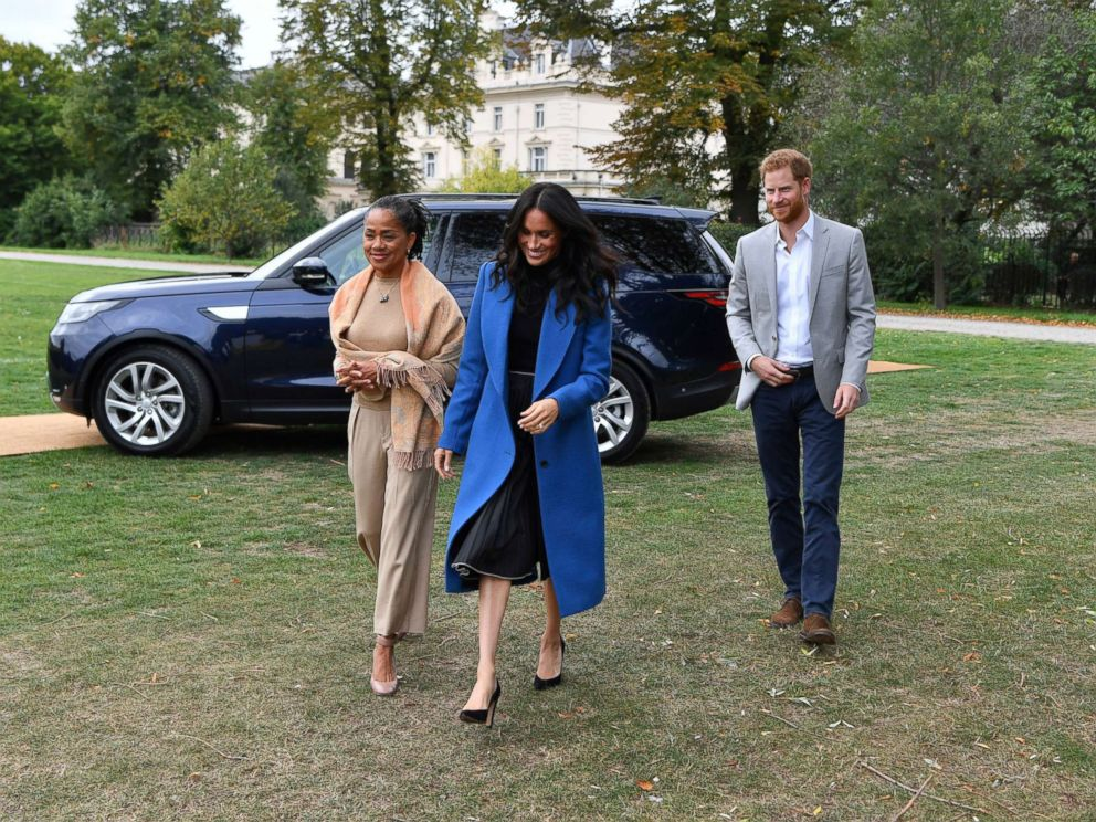 PHOTO: Meghan Markle, the Duchess of Sussex, accompanied by Britains Prince Harry, the Duke of Sussex and her mother Doria Ragland walk to attend a reception at Kensington Palace, in London, Sept. 20, 2018.