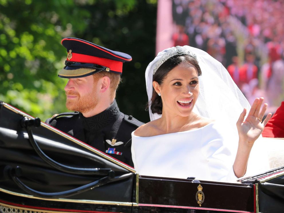 PHOTO: Prince Harry, Duke of Sussex and Meghan Markle, Duchess of Sussex leave Windsor Castle in the Ascot Landau carriage during the procession after getting married, Windsor Castle, May 19, 2018 in Windsor.