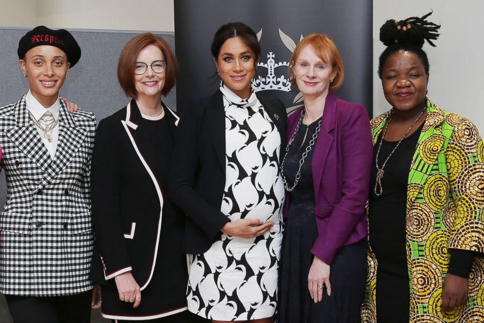 British model Adwoa Aboah, former Australian Prime Minister Julia Gillard, Britain's Meghan, Duchess of Sussex, British journalist Anne  McElvoy and Camfed Regional Director Zimbabwe's Angeline Murimirwa pose before a panel discussion convened by the Queen's Commonwealth Trust to mark International Women's Day in London, March 8, 2019.