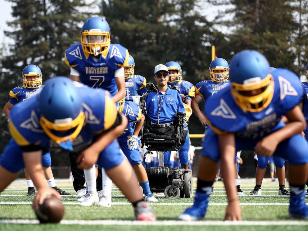 PHOTO: Rob Mendez, the head coach for the Prospect High School Junior Varsity football team, watches his team practice before their first game of the season against Santa Clara High School, Aug. 24, 2018, in Saratoga, Calif.