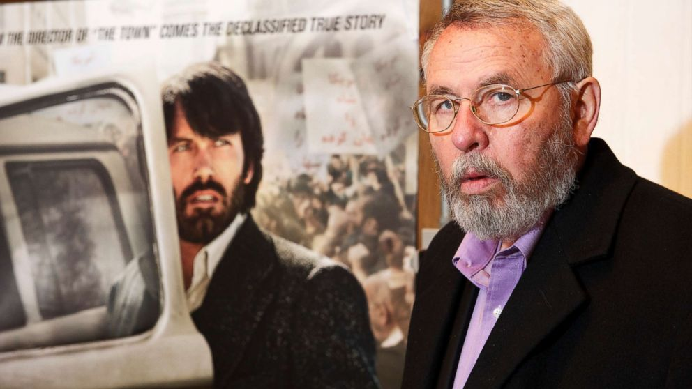 Retired CIA operative Tony Mendez photographed at his gallery in rural Maryland with the movie poster of Argo, and Ben Affleck in his role, Feb. 19, 2013.