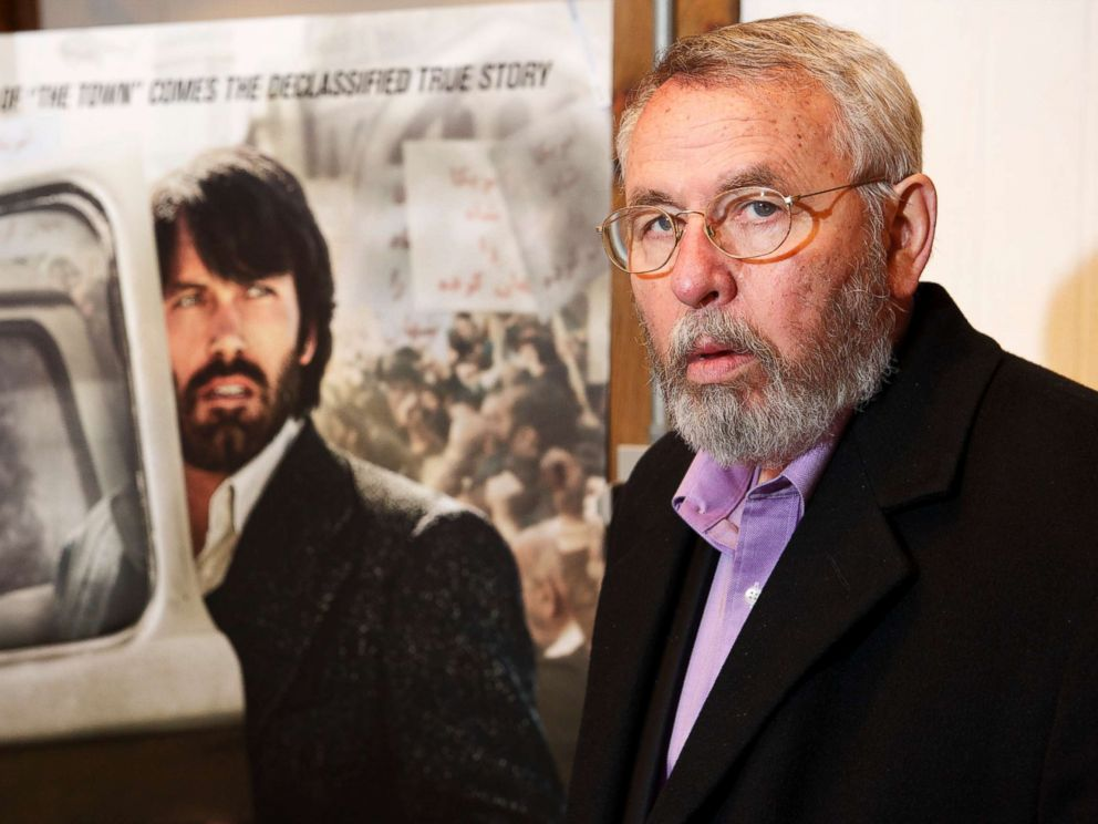 PHOTO: Retired CIA operative Tony Mendez photographed at his gallery in rural Maryland with the movie poster of Argo, and Ben Affleck in his role, Feb. 19, 2013.