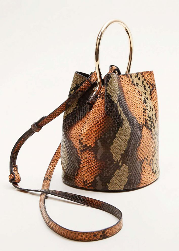 PHOTO: Style Hint: At first glance you may think this bold faux snakeskin bag should be worn with solid colors, but this fall is all about maximalism. This bag will play well with other animal prints and plaids in the same color family.
