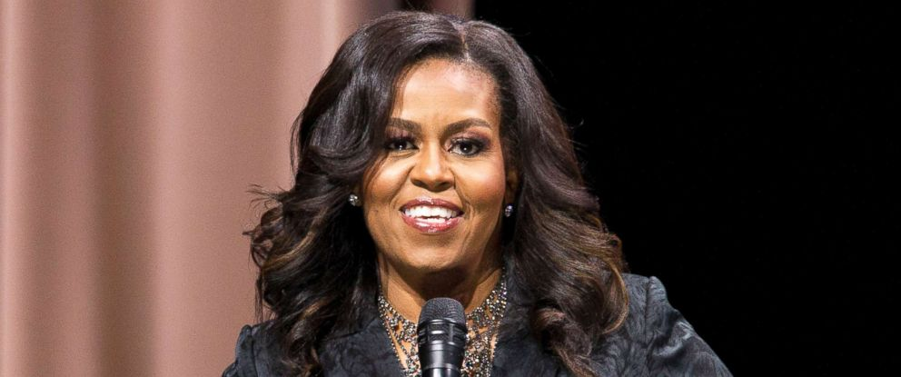 """PHOTO: Former first lady Michelle Obama speaks to the audience during a stop on her book tour for """"Becoming,"""" in Washington D.C., Nov. 25, 2018."""