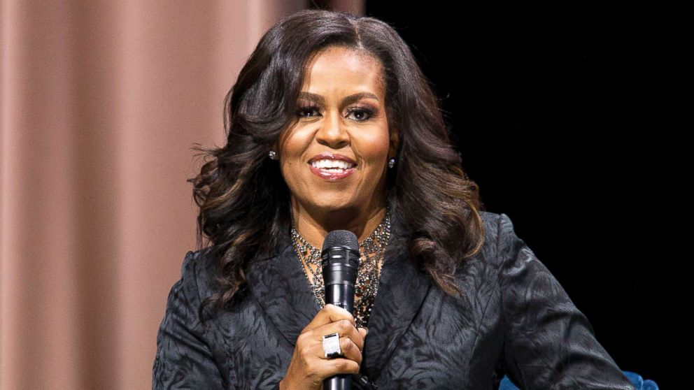"""Former first lady Michelle Obama speaks to the audience during a stop on her book tour for """"Becoming,"""" in Washington D.C., Nov. 25, 2018."""