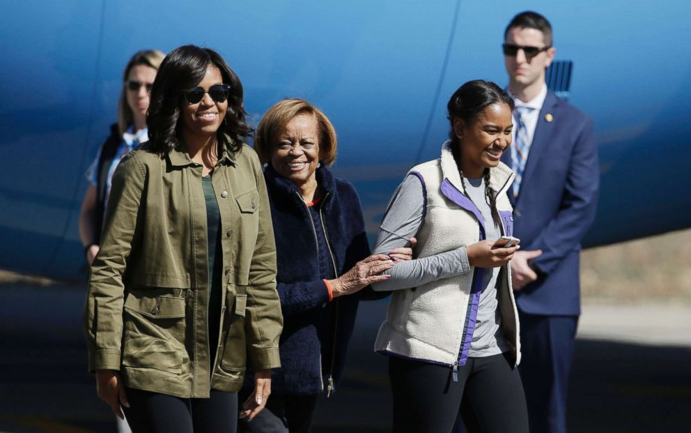In this March 24, 2016 file photo first lady Michelle Obama, right, her mother Marian Robinson, center, and daughter Sasha arrive at Bariloche, Argentina.