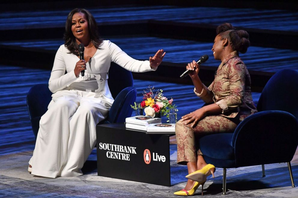 PHOTO: Former first lady Michelle Obama speaks with Nigerian novelist Chimamanda Ngozi Adichie at the Royal Festival Hall in London on Dec. 3, 2018.