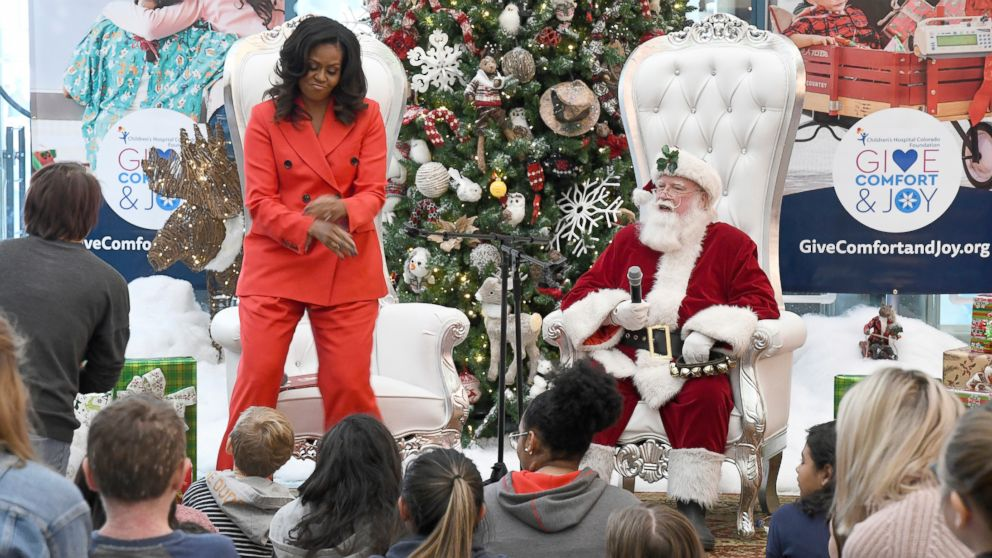 Former first lady Michelle Obama dances after a patient at Children's Hospital Colorado in Aurora, Colo., asks her about her favorite moves Thursday, Dec. 13, 2018.