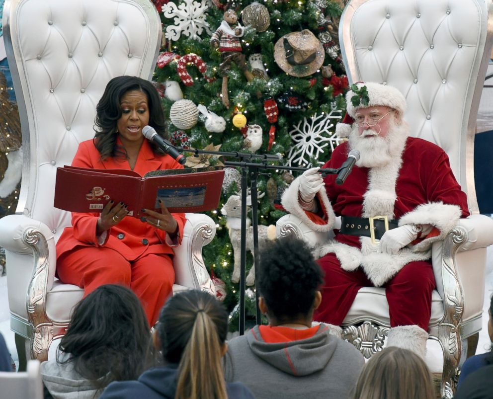 "Former first lady Michelle Obama reads ""The Night Before Christmas"" to children at Children's Hospital Colorado in Aurora, Colo. on Dec. 13, 2018."