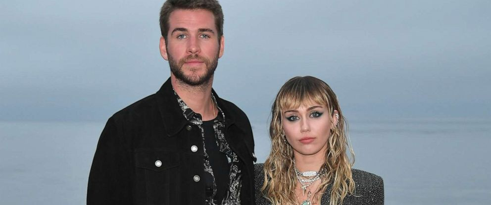 PHOTO: Liam Hemsworth and Miley Cyrus attend the Saint Laurent Mens Spring Summer 20 Show Photo Call, June 6, 2019, in Malibu, Calif.