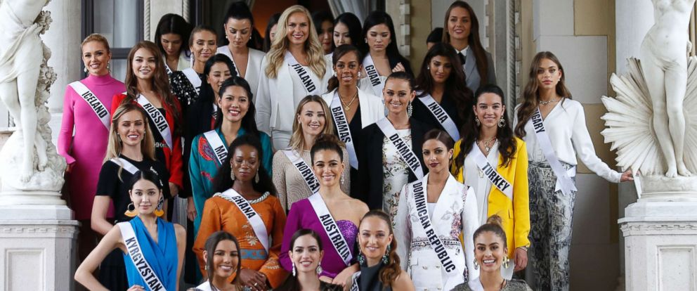 PHOTO: Miss Universe 2018 contestants pose for photos as the visit the Government House after their meeting with Thai Prime Minister in Bangkok on December 11, 2018.