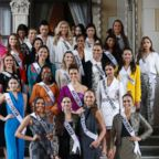 Miss Universe 2018 contestants pose for photos as the visit the Government House after their meeting with Thai Prime Minister in Bangkok on December 11, 2018.