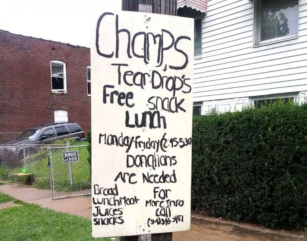 PHOTO: A sign is posted in Champale Andersons St. Louis neighborhood advertising her free lunch program.