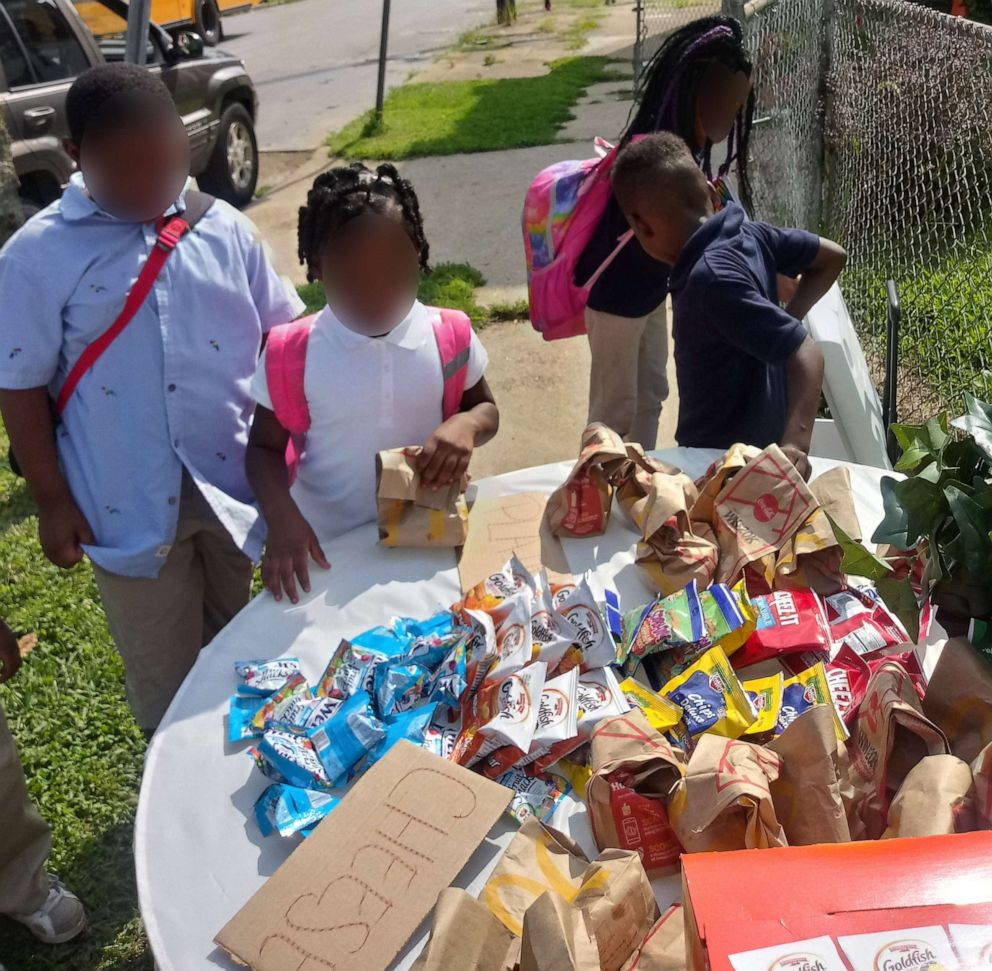 PHOTO: Kids stop by Champale Andersons home after school to pick up food.