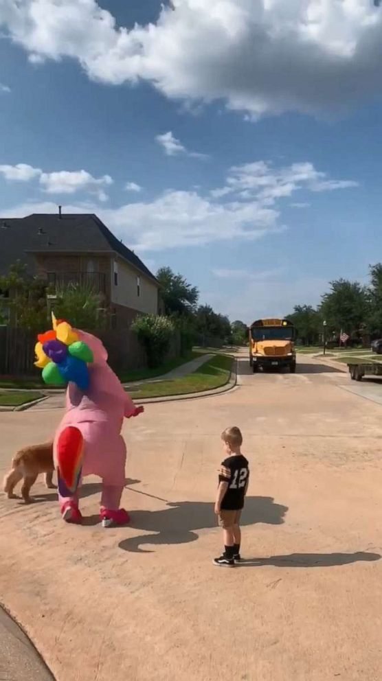 PHOTO: Dad Chris Scandridge of Texas, filmed last week as his wife Somer Scandridge danced up the block in her giant, pink costume to greet 6-year-old Madison.