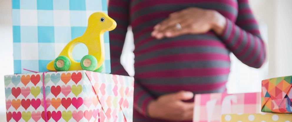 PHOTO: A pregnant woman is surrounded by gifts in an undated stock photo.