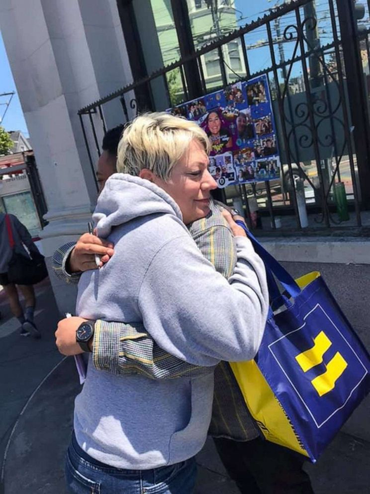 PHOTO: Sara Cunnningham of Oklahoma City, Oklahoma, launched Free Mom Hugs, a group of affirming parents and allies who love the LGBTQ+ community unconditionally, in 2016. She also stnads in for parents of gay couples at weddings.