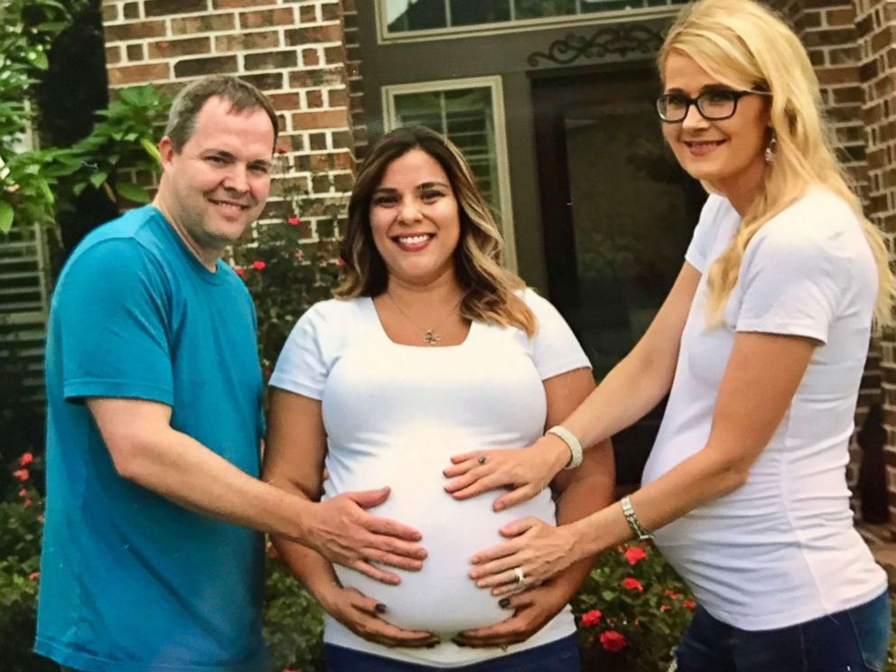 PHOTO: James and Andrea Valentine pose with their neighbor and surrogate, Tawnee Gonzalez of Cypress, Texas.