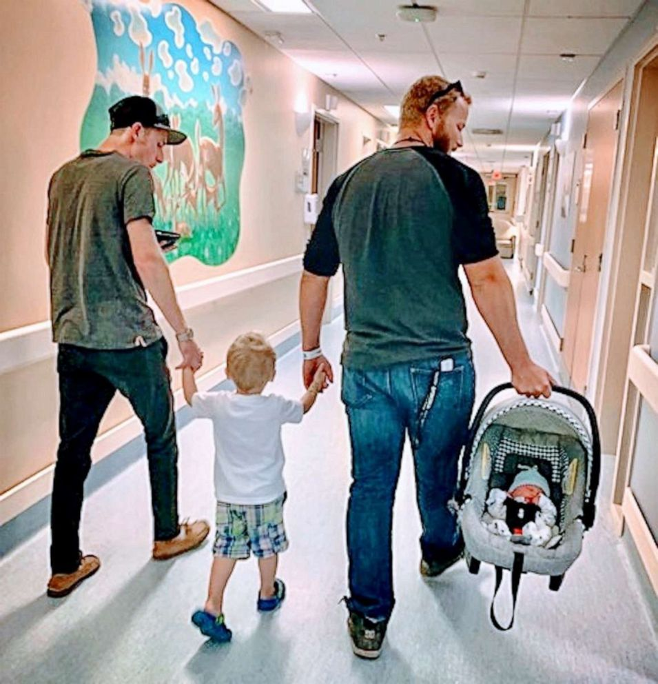 PHOTO: Madison Holley of Corunna, Ontario, shared an image of her former partner and current fiance exiting the hospital hand-in-hand with her toddler son, along with her newborn
