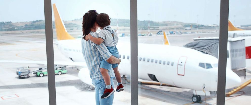 PHOTO: A mother and son are pictured at an airport in this undated stock photo.