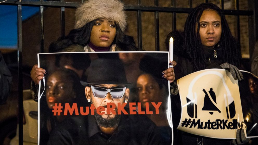 "#MuteRKelly supporters protest outside R. Kelly's studio, Wednesday, Jan. 9, 2019 in Chicago. Lifetime's ""Surviving R. Kelly"" series which aired earlier this month, looks at the singer's history and allegations that he has sexually abused women and girls. Kelly, who turned 52 on Tuesday, has denied wrongdoing."