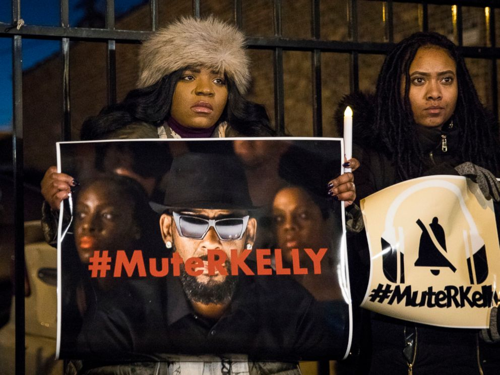PHOTO: #MuteRKelly supporters protest outside R. Kellys studio, Wednesday, Jan. 9, 2019 in Chicago. Lifetimes Surviving R. Kelly series which aired earlier this month, looks at the singers history and allegations that he has sexually abused women.