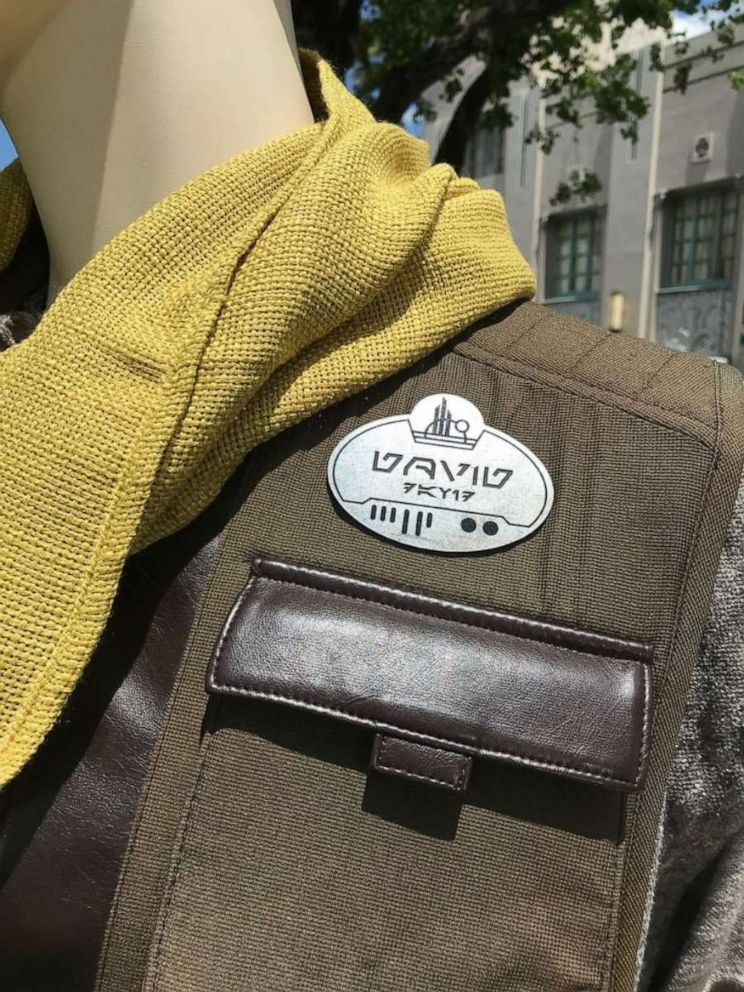 PHOTO: Name tags worn by the villagers in Star Wars: Galaxys Edge are in both English and Aurebesh.