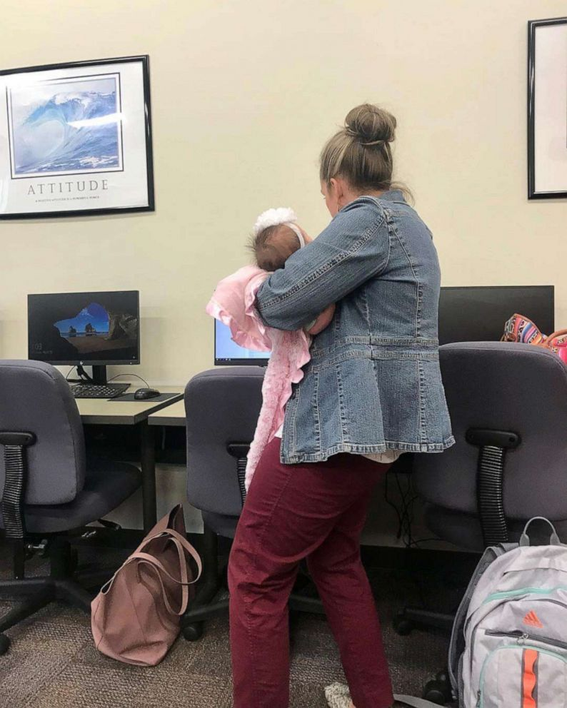 PHOTO: Dr. Julie George held the baby of her student, Katie Lewis, while Lewis took a test.