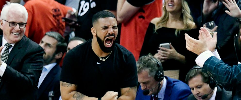 PHOTO:Rapper Drake reacts during the second half of basketball action between the Toronto Raptors and the Golden State Warriors in Game 5 of the NBA Finals in Toronto, June 10, 2019.