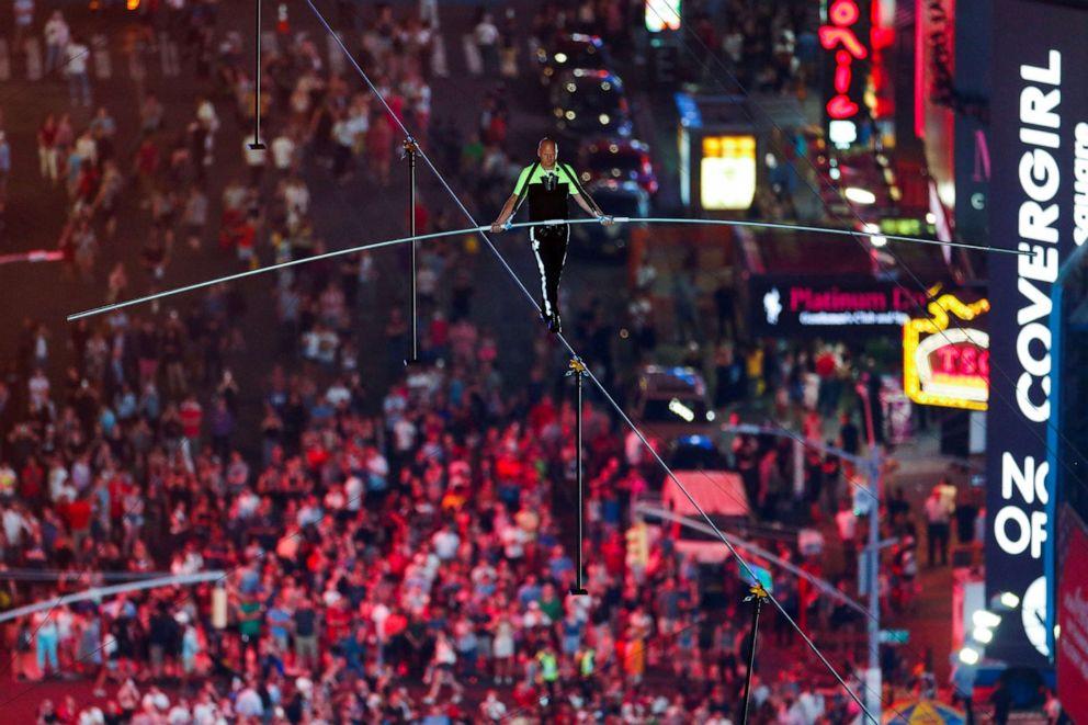 PHOTO: Nik Wallenda walks the highwire over Times Square in N.Y., June 23, 2019.